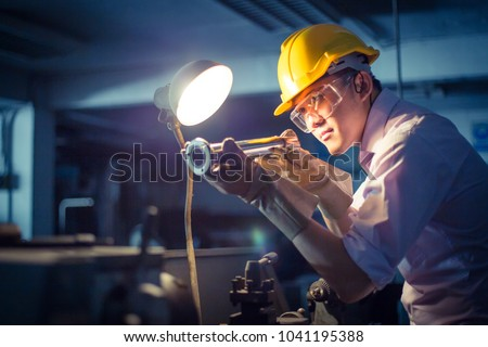 Portrait of heavy industry manual asian worker labor with grinder welder, asian man wearing mask with his hands grinding in heavy industry, labor day concept