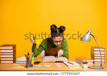 Portrait of her she attractive focused knowledgeable brainy diligent woman nerd reading book finding solution drinking caffeine isolated bright vivid shine vibrant yellow color background Stock foto ©