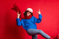 Portrait of her she nice attractive crazy cool overjoyed carefree naughty cheerful girl wearing casual festal outfit dancing showing horn sign isolated bright vivid shine vibrant red color background