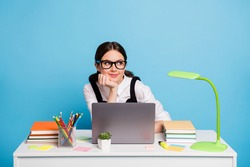 Portrait of her she nice attractive dreamy cheery schoolgirl preparing entering test exam online doing homework task academic subject isolated on bright vivid shine vibrant blue color background