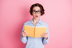 Portrait of her she nice attractive lovely amazed stunned cheery brown-haired girl schoolgirl reading interesting book diary learning subject isolated pink pastel color background