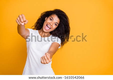 Portrait of her she nice attractive lovely charming cheerful cheery funny wavy-haired girl driving invisible rudder helm isolated over bright vivid shine vibrant yellow color background