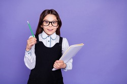 Portrait of her she nice attractive lovely cheerful cheery brainy genius diligent pre-teen girl nerd doing class home work task solution science isolated over bright vivid shine violet background