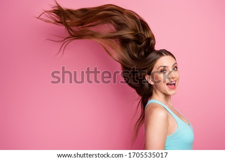 Portrait of her she nice attractive lovely cheerful cheery straight-haired girl ideal perfect clean smooth hair flying anti dander dandruff medicine isolated on pink pastel color background