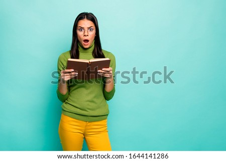 Portrait of her she nice attractive lovely intellectual stunned girl reading scientific work overreacting isolated on bright vivid shine vibrant blue green turquoise color background