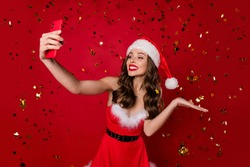 Portrait of her she nice attractive lovely lovable fascinating winsome glamorous gorgeous cheerful cheery wavy-haired lady making selfie having fun isolated on bright vivid shine red background