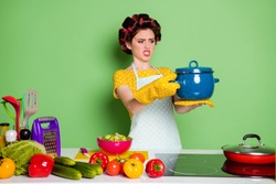 Portrait of her she nice attractive mature glamorous housewife cooking meal holding on palm hot vegan soup dislike disgust bad smell spoilt isolated over green pastel color background