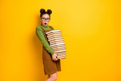 Portrait of her she nice attractive overwhelmed intelligent girl carrying big large pile book materials science project isolated bright vivid shine vibrant yellow color background