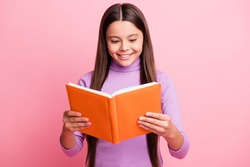 Portrait of her she nice attractive pretty lovely educated cheerful cheery focused long-haired girl reading dictionary paper book isolated over pink pastel color background