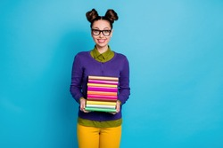 Portrait of her she nice attractive pretty smart clever intellectual cheerful girl geek carrying pile books library isolated on bright vivid, shine vibrant blue green teal turquoise color background