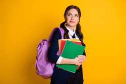 Portrait of her she nice attractive pretty smart clever schoolgirl nerd holding in hand literature going to secondary school isolated on bright vivid shine vibrant yellow color background