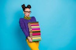 Portrait of her she nice attractive pretty smart clever tired girl geek carrying big large heavy pile books isolated on bright vivid shine vibrant blue green teal turquoise color background