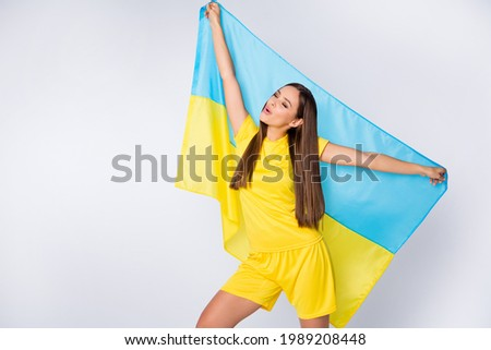 Portrait of her she nice beautiful pretty dreamy cheerful straight-haired girl fan holding in hands Ukrainian flag trip singing anthem hymn isolated over light white gray pastel color background Photo stock ©
