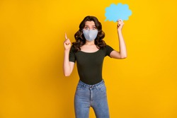 Portrait of her she nice brainy amazed wavy-haired lady wear safety reusable mask stop pandemia holding hand paper cloud pointing up isolated bright vivid shine vibrant yellow color background