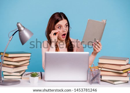 Portrait of her she nice-looking attractive amazed astonished stunned girl reading scientific article discovery at work place station isolated over bright vivid shine blue turquoise background