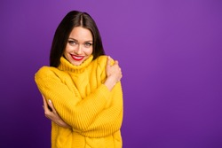 Portrait of her she nice-looking attractive lovely cheerful sweet straight-haired girl hugging herself in warm sweater isolated over bright vivid shine vibrant lilac violet purple color background