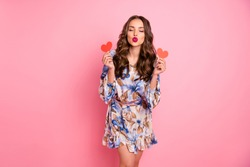 Portrait of her she nice-looking attractive lovely lovable feminine cheerful cheery wavy-haired girl holding in hands two small little heart sending you kiss isolated over pink background