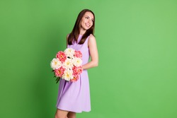 Portrait of her she nice-looking attractive pretty winsome elegant cheerful cheery girl holding in hands fresh bunch flowers prom date festal romantic occasion isolated over green color background