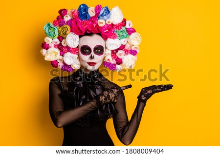 Portrait of her she nice-looking beautiful creepy confident lady holding on palm copy space advert discount Santa Muerte isolated bright vivid shine vibrant yellow color background