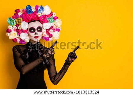 Portrait of her she nice-looking beautiful glamorous confident lady Santa Muerte art demonstrating copy empty blank place space isolated bright vivid shine vibrant yellow color background