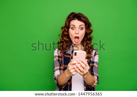 Portrait of her she nice lovely pretty winsome attractive cheerful amazed wavy-haired girl in checked shirt using new dagdet isolated over bright vivid shine green background Stock foto ©