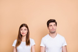 Portrait of his he her she nice attractive lovely curious bewildered couple wearing white t-shirt thinking creating solution learning isolated over beige pastel color background