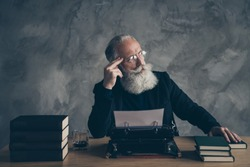 Portrait of his he nice attractive bearded bewildered gray-haired professional expert creative publisher inspiration imagination genius idea solution deciding over concrete wall background