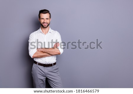 Portrait of his he nice attractive content successful cheerful cheery brunet guy executive professional consultant manager folded arms isolated over gray pastel color background Stock photo ©