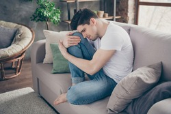 Portrait of his he nice attractive depressed miserable dumped guy sitting on divan suffering heartbreak at modern industrial loft brick interior style living-room