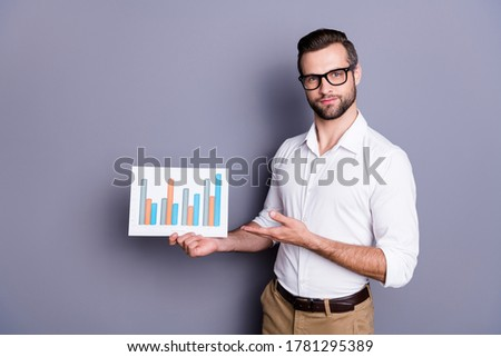 Portrait of his he nice attractive successful man qualified experienced skilled marketing director demonstrating chart data isolated over grey violet purple pastel color background
