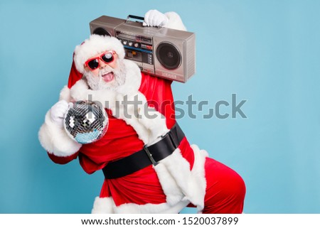 Portrait of his he nice cool fat cheerful cheery glad excited ecstatic overjoyed crazy carefree bearded Santa carrying tape player dancing having fun isolated on blue turquoise pastel color background #1520037899
