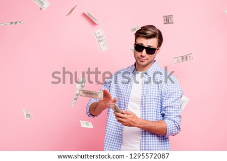 Portrait of his he nice cool trendy content attractive handsome reckless careless carefree guy wearing checked shirt throwing money away wealth isolated over pink pastel background