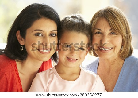 Portrait Of Hispanic Grandmother, Mother And Daughter Relaxing At Home #280356977