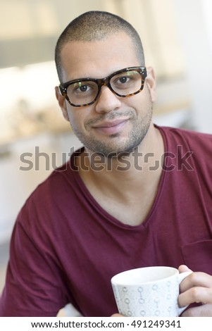 portrait of hispanic guy with...