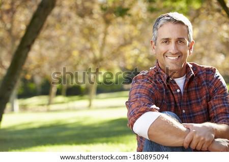 Portrait Of Hispanic Man In Countryside #180895094