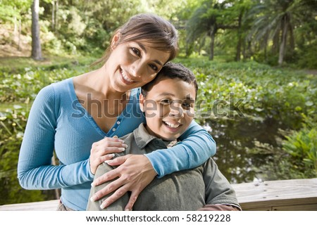 Portrait of Hispanic mother and 10 year old son outdoors in park #58219228