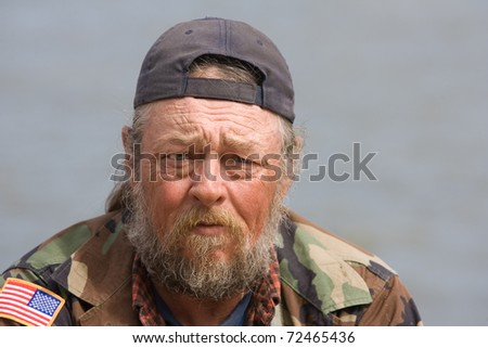Portrait of homeless man with beard