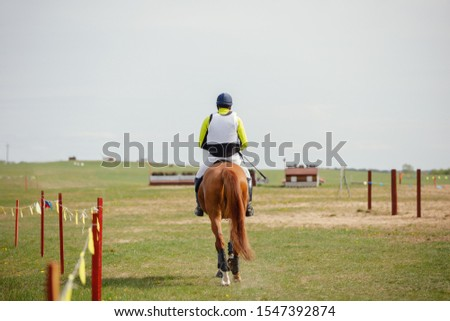 portrait of horse and rider going to start eventing competition