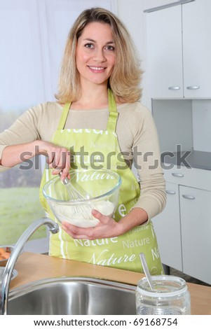Portrait of housewife preparing meal