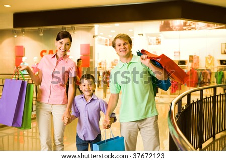 Portrait of husband and wife with their son in trade center