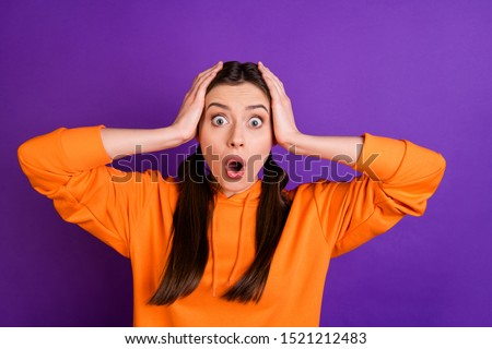 Portrait of impressed disappointed youth girl scream omg hear terrible news novelties wear sportive outfit isolated over violet purple bright color background