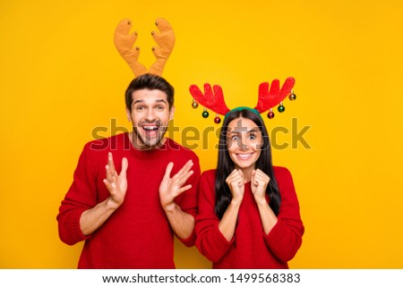 Portrait of impressed spouses scream wow omg wait for sales discount wear red sweater isolated over yellow background