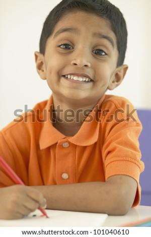 Portrait of Indian boy drawing