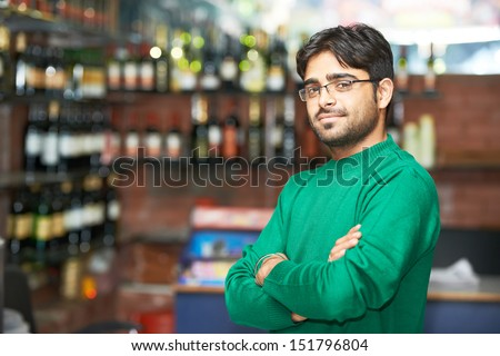 Portrait of Indian sikh man seller with bushy beard at shop #151796804