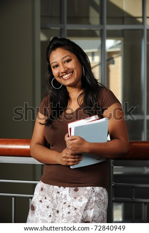 Portrait of Indian student smiling indoors