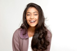 portrait of indian teenager smiling girl over white background