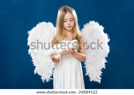 Portrait of innocent angel with nice dove looking at it with love