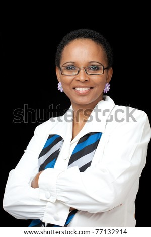 Portrait of intellegent African American business woman wearing white shirt, scarf and glasses