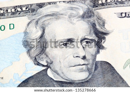 Portrait of Jackson in front of the dollar bill