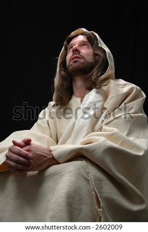 Portrait of Jesus in prayer with black background